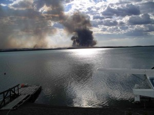 watching-forest-fire-smoke-from-lake-dock-300x225